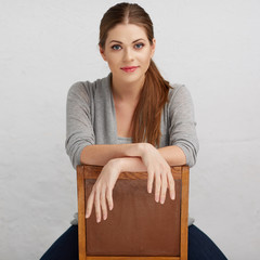 Woman sitting on chair , beautiful model . Chair back .