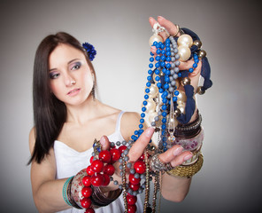 summer girl plenty of jewellery beads in hands