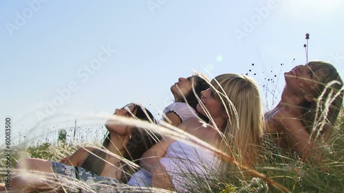 Four beautiful women in a spring field. Slow motion