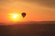 Hot air balloon is flying at sunrise