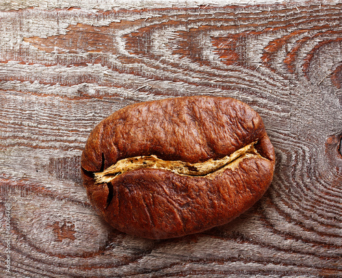 Black coffee grain, bean on wooden background.