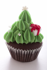 christmas tree cupcake on white background