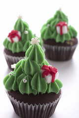 christmas tree cupcake on white background