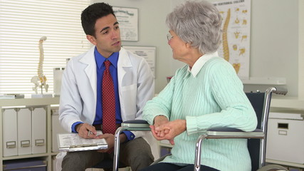 Elderly woman talking with Mexican doctor