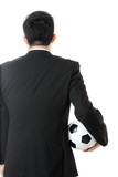 Rear view of businessman with soccer ball