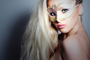 Beautiful Blond Woman in Carnival Mask. Masquerade.Sexy Girl
