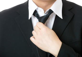 Businessman adjust tie
