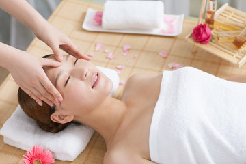 .A young woman enjoy massage.