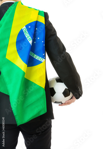 Asian business man holding soccer ball with Brazil flag