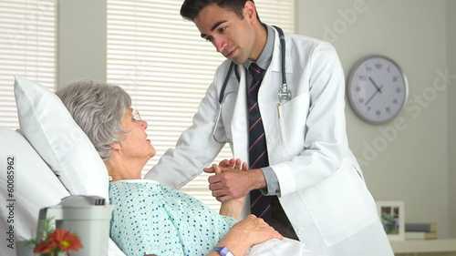 Mature woman being comforted by Mexican doctor