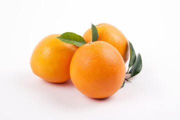 Fresh oranges with leaves on a white background