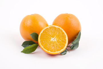 Fresh oranges with half on a white background