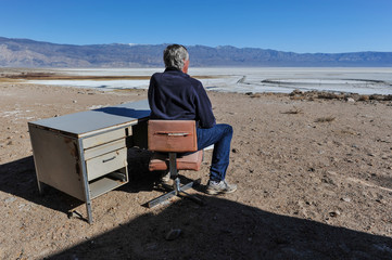 Man sitting at a desk in the desert