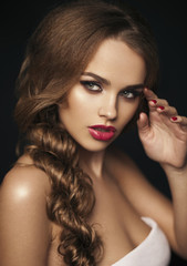 Beautiful girl with red lips. Red lipstick. Red manicure. long h
