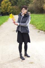 Woman alone in the autumn walk