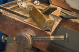 Old vise and tool in a workshop still-life