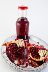 pomegranate  and juice in a bottle