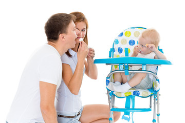 Young parents feed  baby..