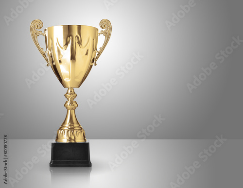 champion golden trophy over grey background
