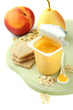 Tasty yogurt in open plastic cup, cookies and fruit,