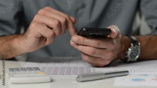 Businessman working with smartphone. LOOPABLE