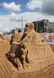 PERM - JUNE 10: Sand sculpture Charles Darwin at festival poster