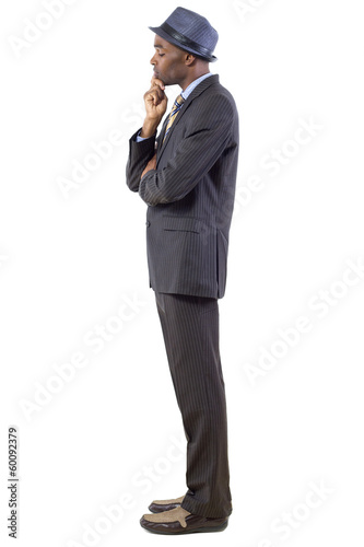 young black businessman looking down and contemplating