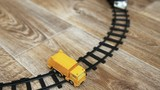 Black toy train and toy car wreck. Selective focus.