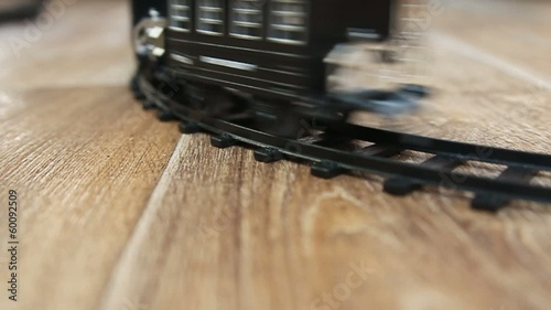Black train toy. Selective focus with shallow depth of field.