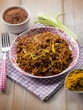 red rice with curry and leek, selective focus