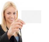 Smiling businesswoman holding a business card