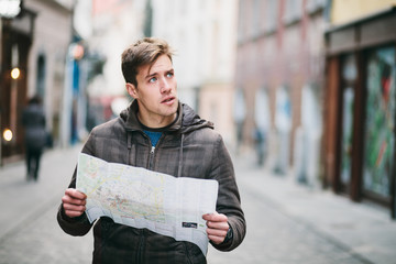 Tourist with city map on a trip in city