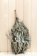 Eucalyptus broom for a bath on a wooden surface.