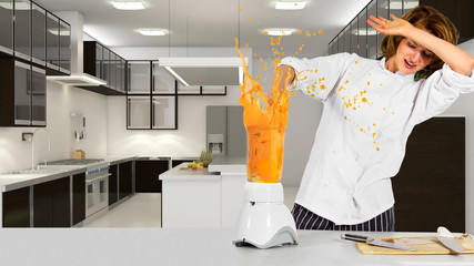 young female chef making an mess with a blender