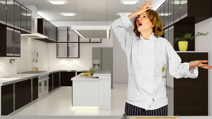 Stressed out female chef in a commercial kitchen