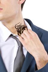 young caucasian businessman revealing a hidden tattoo