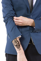 young caucasian businessman revealing a hidden tattoo