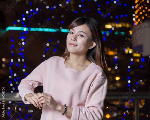 Attractive Asian Woman in front of bright LIghts