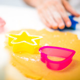 little girl in the kitchen preparing cookies