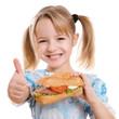 canvas print picture - lachendes Kind hält Daumen hoch zu gesunder Ernährung