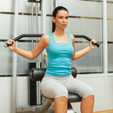 Young woman doing exercise for strengthening back poster