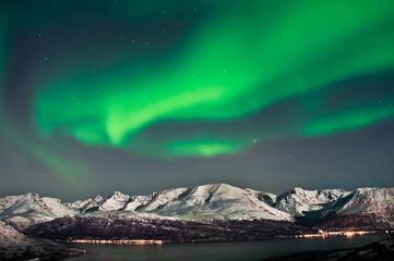 Northern lights over fjords in Norway