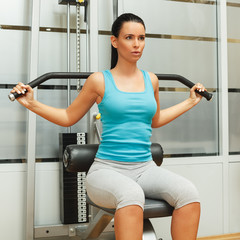 Young woman doing exercise for strengthening back