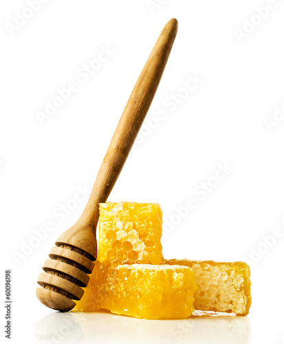 honey comb with a wooden dipper