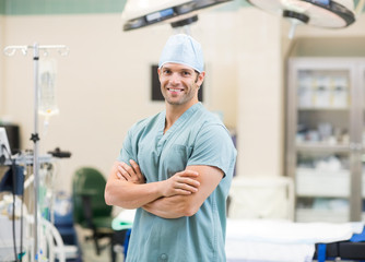 Surgeon Standing Arms Crossed In Operation Room