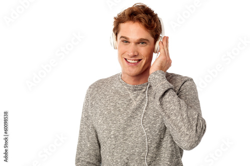 Young handsome guy enjoying music