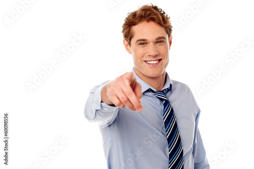 Businessman pointing towards camera