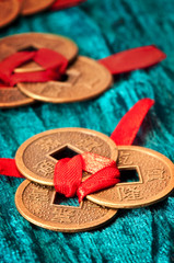 Chinese lucky coins tied with red ribbon