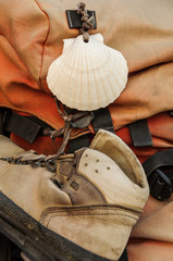 Shell and shoe on a Compostela pilgrim backpack