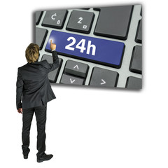 Businessman activating a 24h key on a keyboard